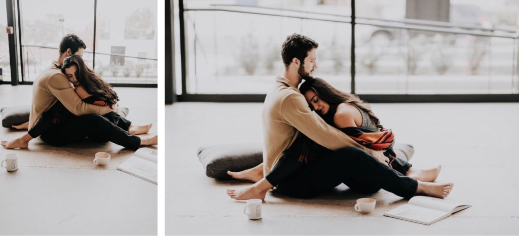 engaged couple laying down together and relaxing during their at-home engagement photos