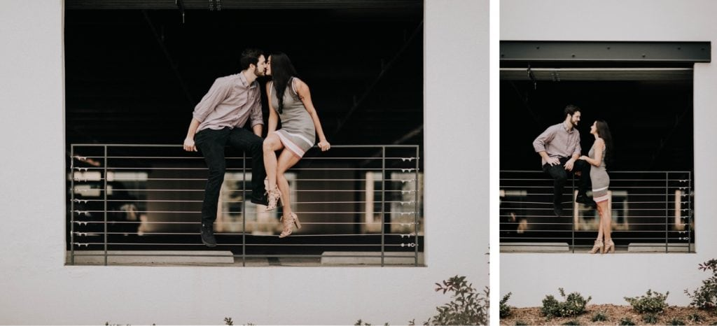 couples photos in a parking deck during their at-home engagement