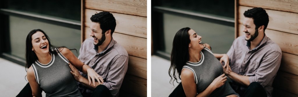 couple kissing and tickling each other during their at-home engagement photos
