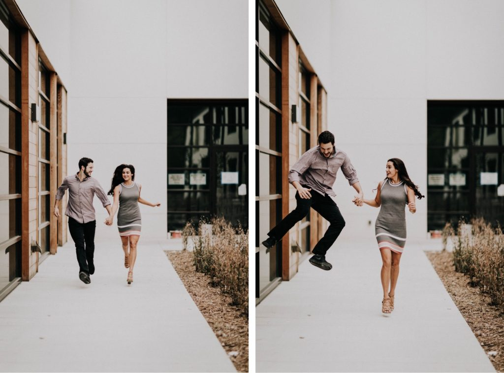 couple running with each other outside apartment during their at-home engagement