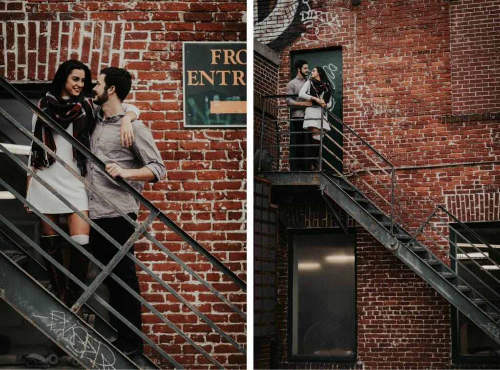 engaged couple hanging out outside an industrial apartment during their at-home engagement