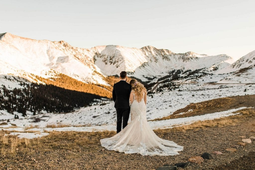 reasons to elope | couple eloping on a mountaintop