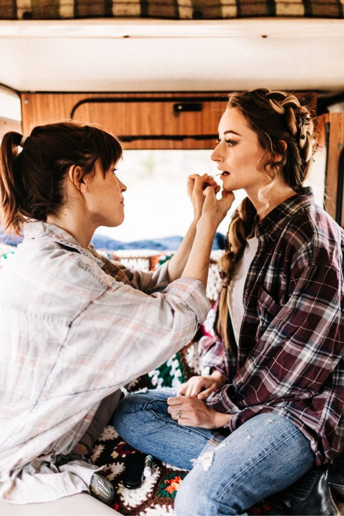 adventure bride getting her makeup done before her Colorado camper van wedding elopement in the Rocky Mountains