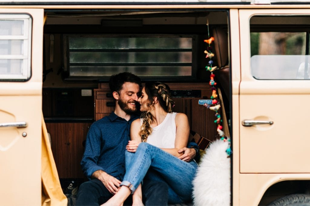 couple hanging out at their camper van before their Rocky Mountain camper van wedding elopement