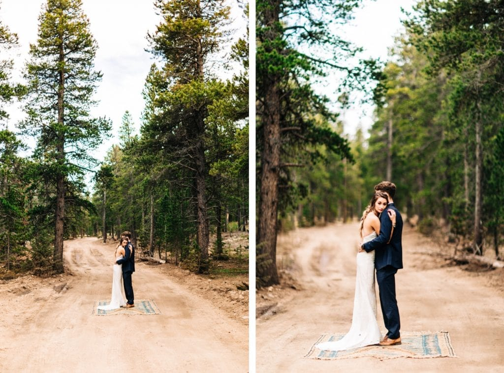 couple wandering down a dirt road during their camper van elopement wedding in the Colorado Rocky Mountains