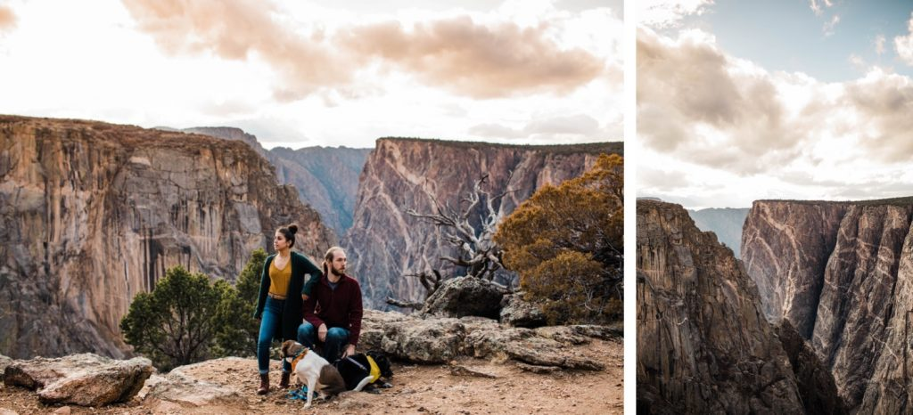couple standing on the edge of a canyon cliff with their two dogs
