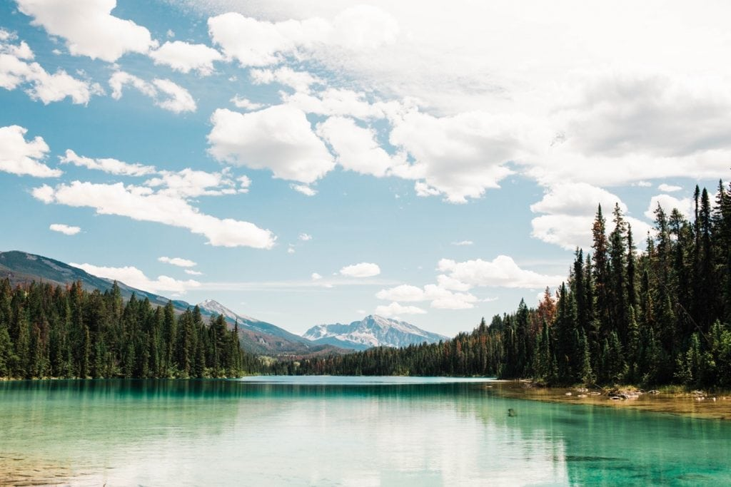 aqua colored alpine lake in the Rocky Mountains