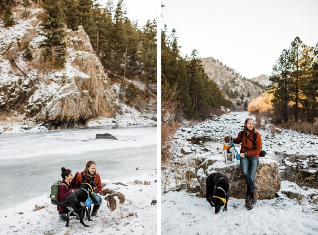 couple and their dogs hiking by a frozen river in the Rocky Mountains outside Fort Collins Colorado