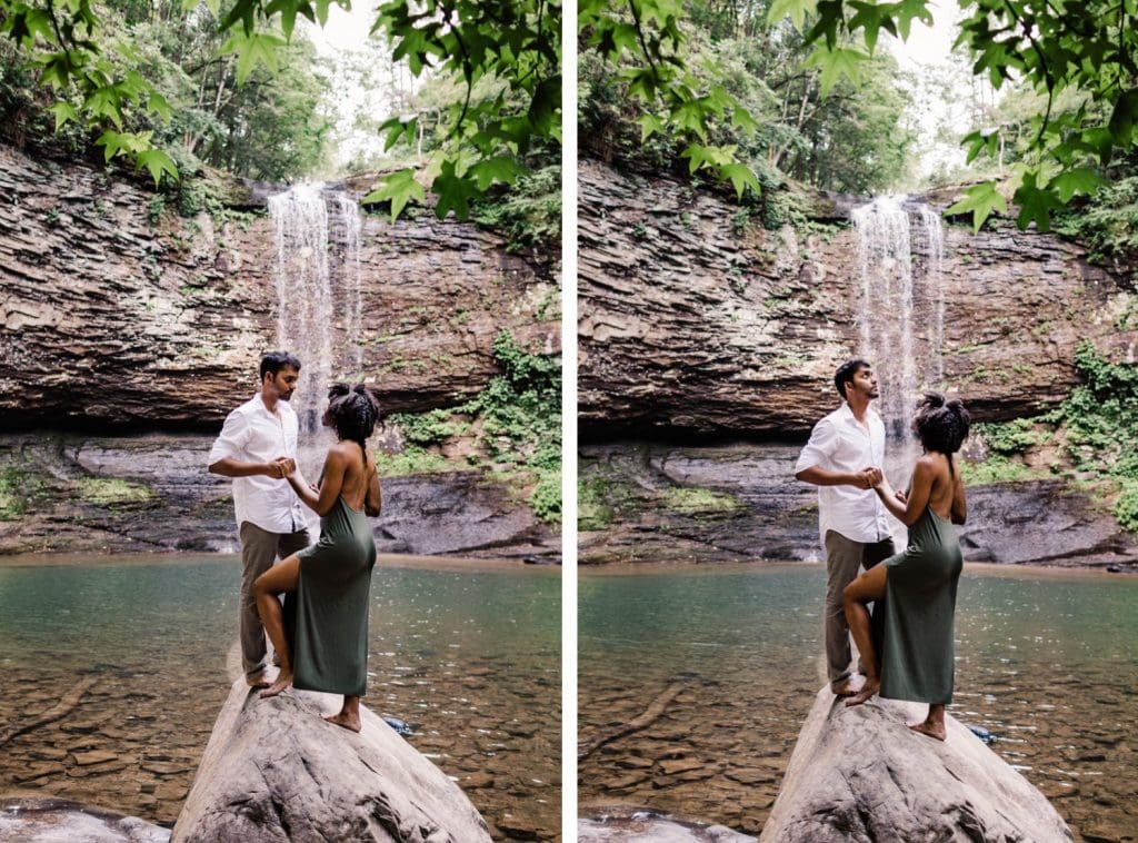 engaged couple admiring a giant waterfall during their waterfall engagement session