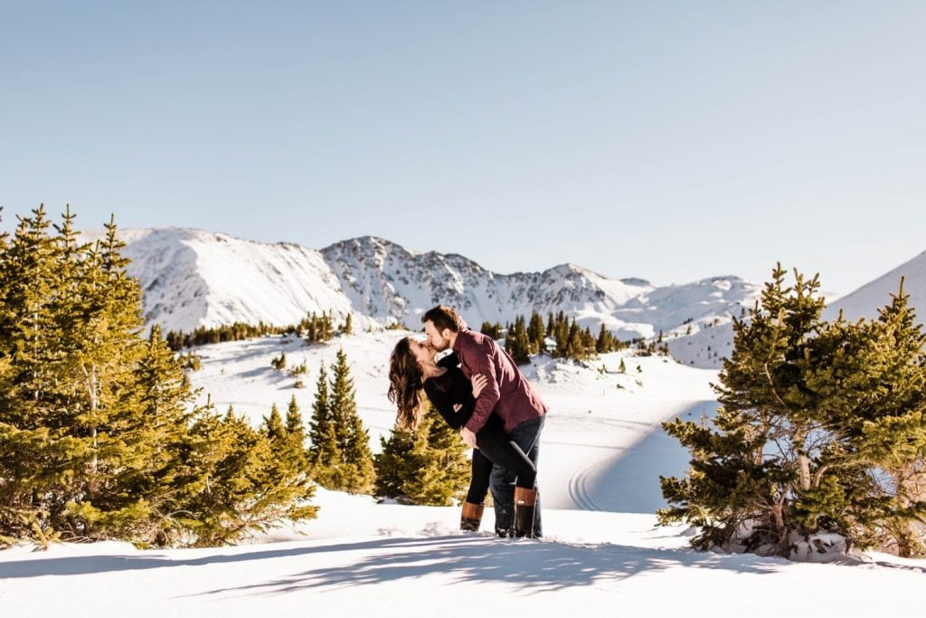 couple kissing in the snow during their snowy Colorado engagement photos in the Rocky Mountains