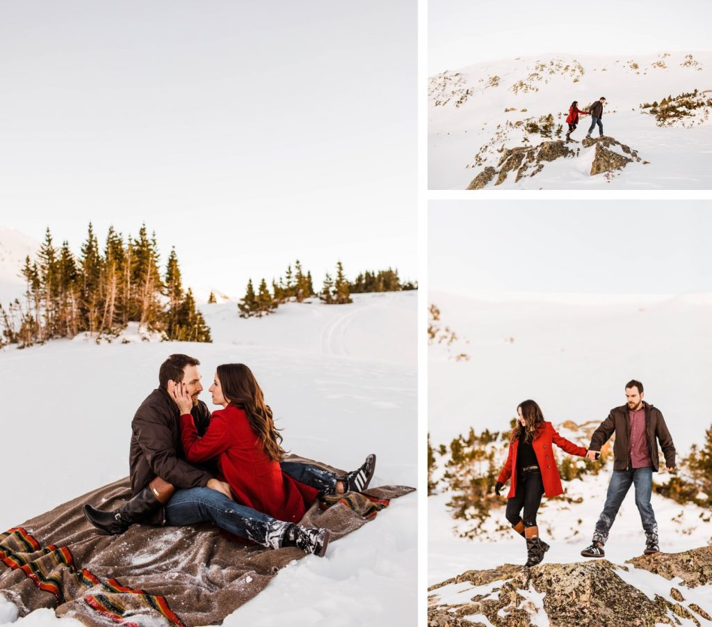 couple sitting on a Pendleton blanket during their snowy Colorado winter engagement photos in the Rocky Mountains