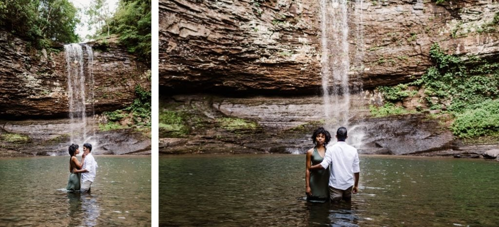 engaged couple in the water beneath a waterfall during their engagement photos