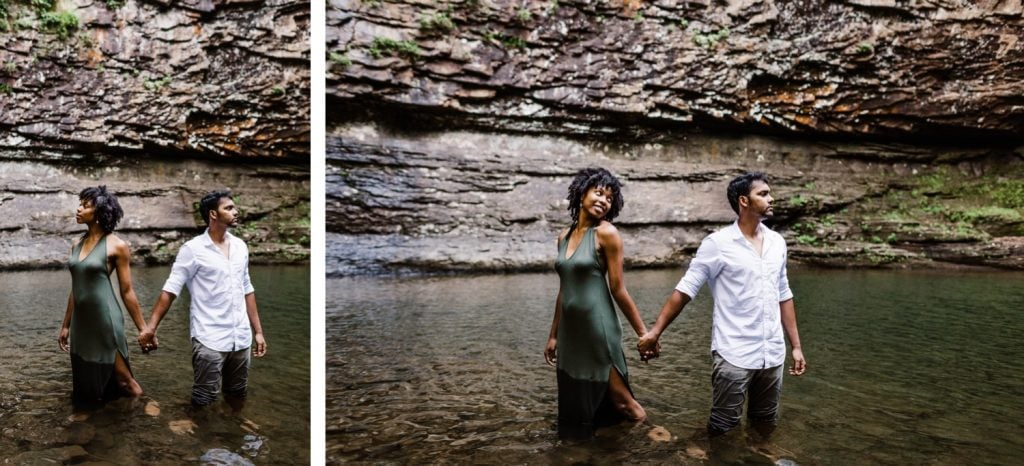 engaged couple holding hands under a waterfall
