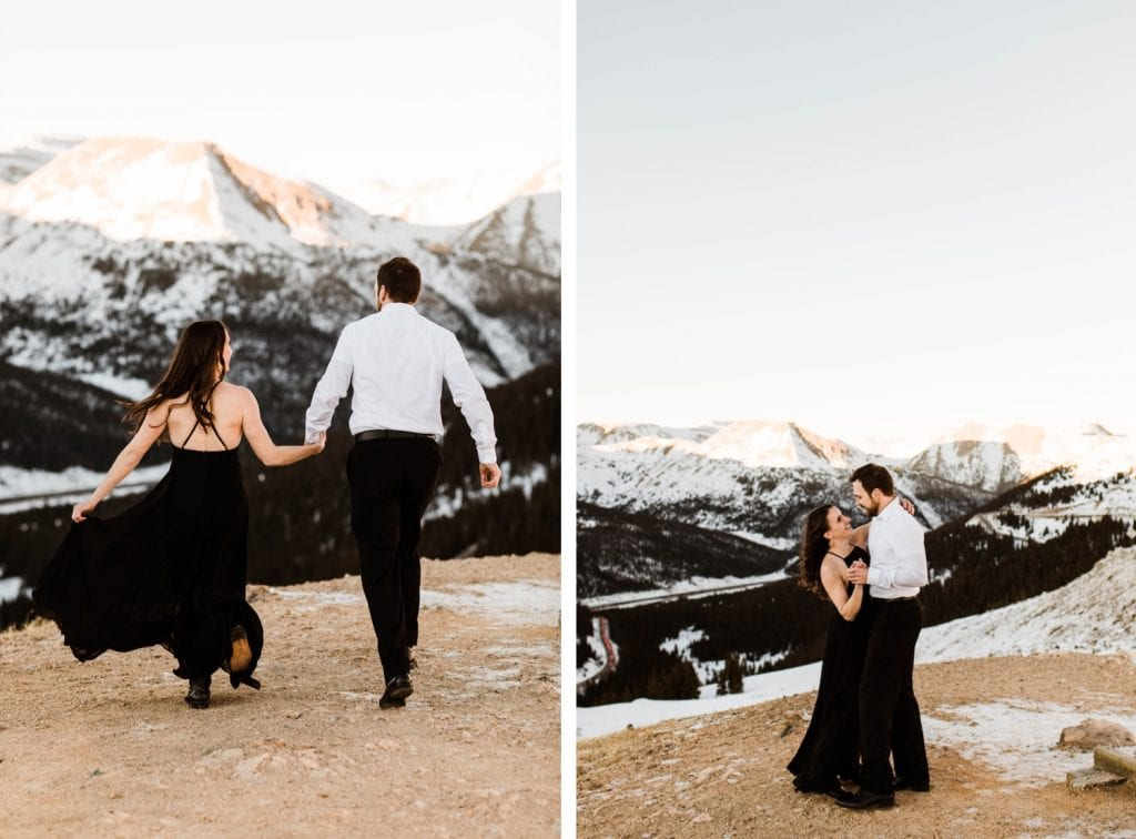 couple running through the snowy Rocky Mountains during their snowy Colorado engagement photos
