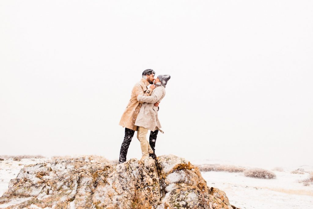 snowy engagement photos in Aspen Colorado after couple gets engaged at Maroon Bells