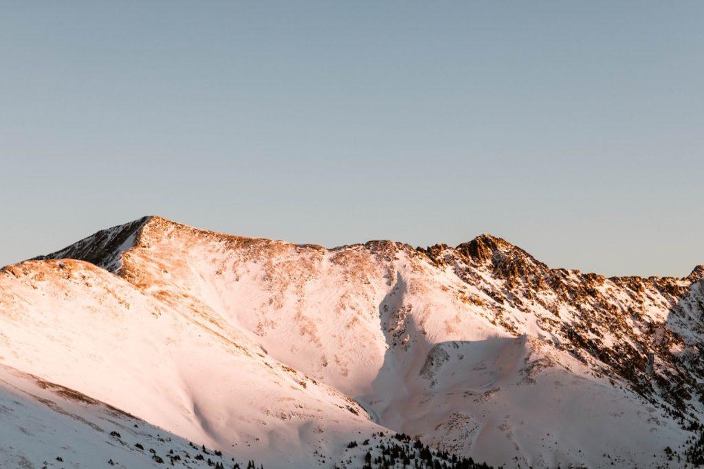 sunset alpenglow on the snowy Colorado Rocky Mountains near Breckenridge