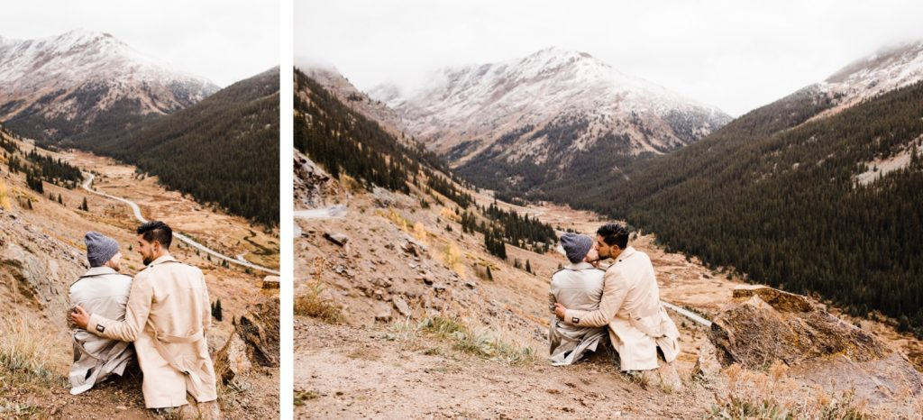 engaged couple standing on a Rocky Mountain pass overlook after their Maroon Bells proposal in Aspen Colorado