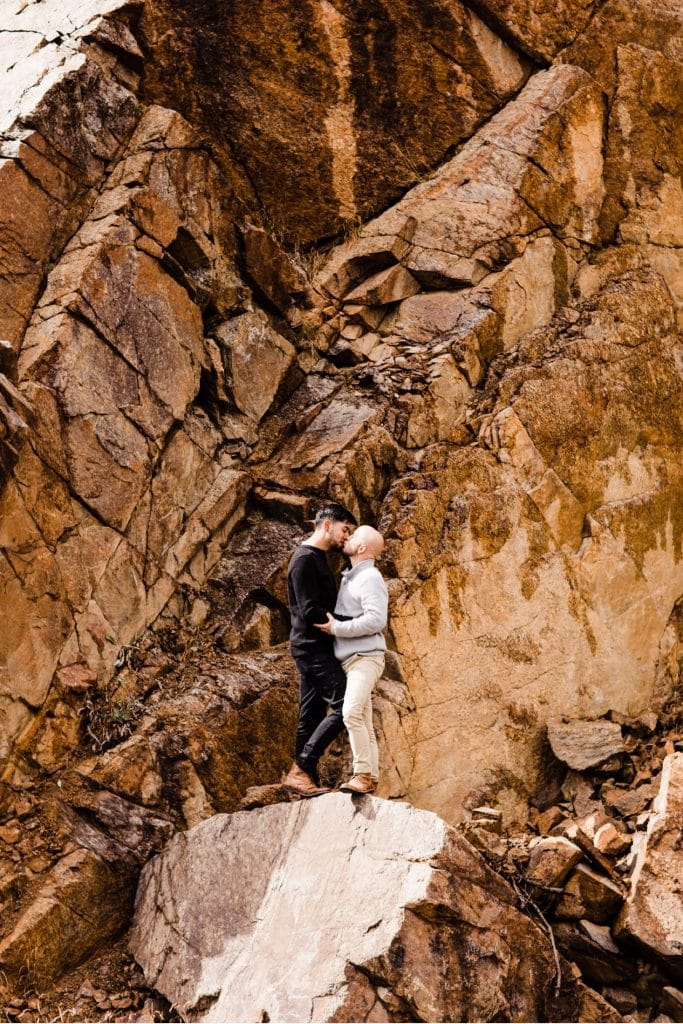 engaged couple rock climbing in Aspen Colorado after their Maroon Bells proposal in the fall