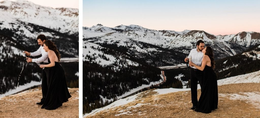 engaged couple popping champagne during their snowy Colorado winter engagement session