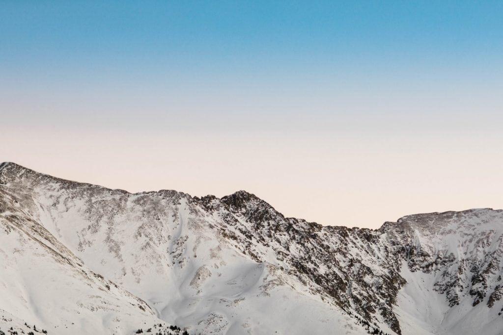blue hour over the snow covered mountains near Breckenridge Colorado