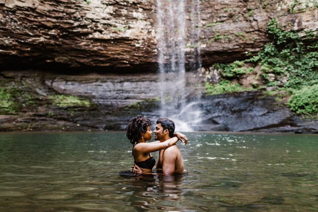 engaged couple kissing during their waterfall engagement session