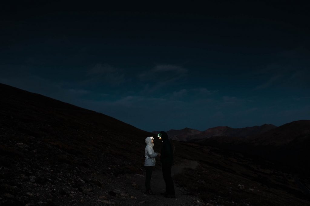 hiking with headlamps on a post-wedding adventure session in the mountains | best Estes Park wedding photographers