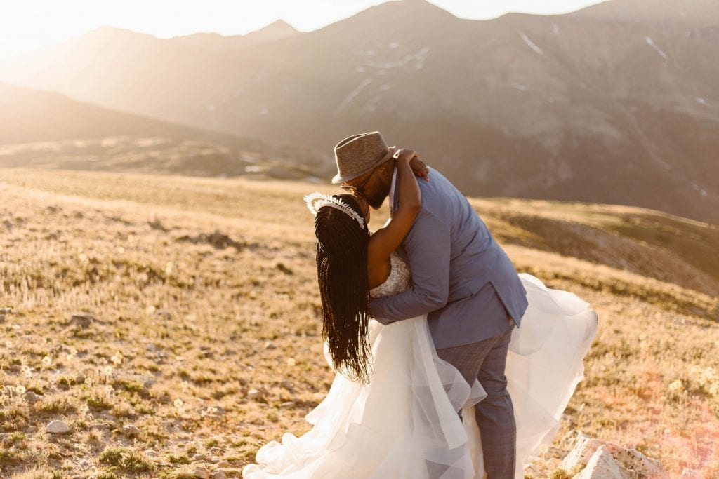 couple sharing first kiss during their self solemnization Colorado ceremony | self uniting marriage photographed by Sheena Shahangian Photography LLC