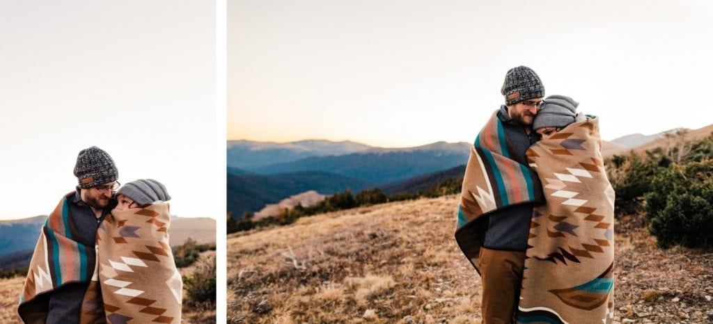 engaged couple curled up in a Pendleton blanket during their Colorado Rocky Mountain National Park engagement session | Rocky Mountain elopement photographers