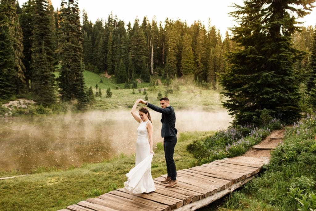 eloping couple dancing by an alpine lake during their Mt Rainier elopement | Washington state elopement