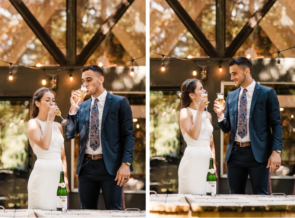 eloping couple popping champagne after their Mt Rainier elopement | Washington state elopement in an a-frame cabin