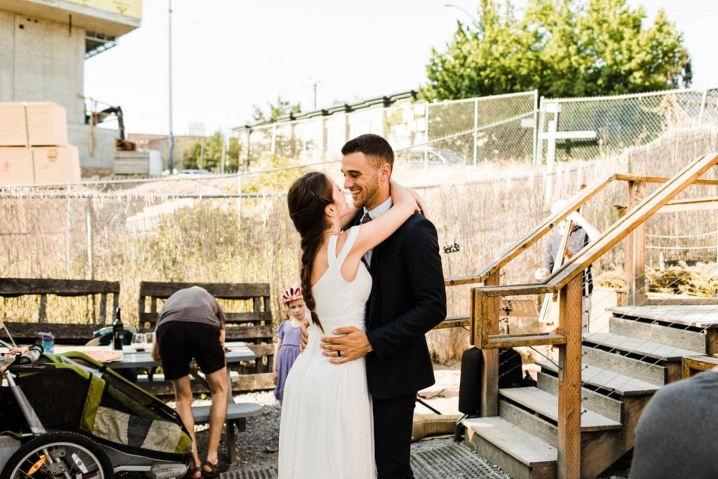 couple dancing at pizza restaurant Humble Pie in Seattle after their Mt Rainier elopement | Washington state national park elopement photographers