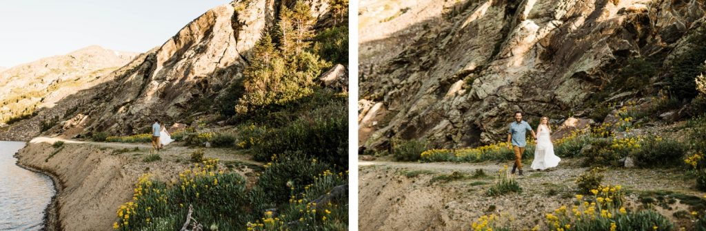 eloping couple running through a meadow of mountain wildflowers while holding hands | Breckenridge wedding photographers