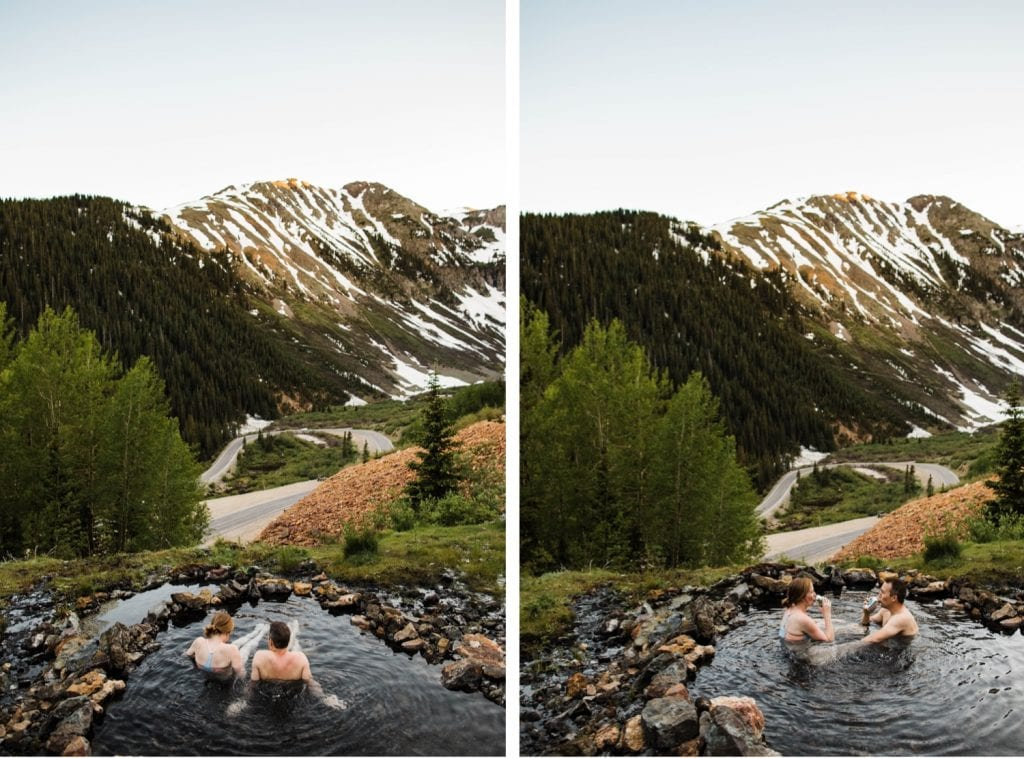 couple hanging out in a mountain hot spring during their Telluride engagement photos in the San Juan mountains of Colorado