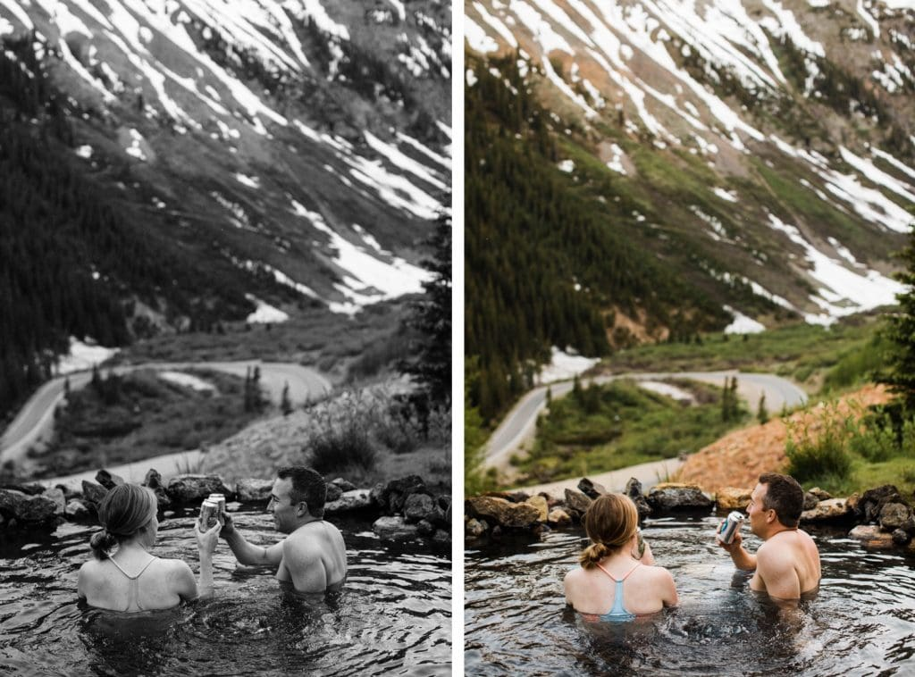 engaged couple drinking cider in a hot spring during their Telluride engagement photos in the San Juan mountains of southwest Colorado