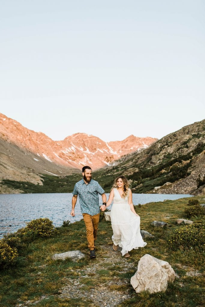Colorado elopement couple running through the mountains during their adventure wedding in Breckenridge