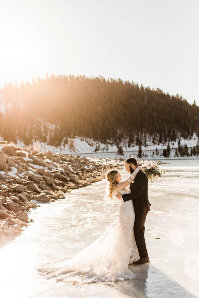 Sapphire Point Colorado elopement on a frozen lake photographed by adventure wedding photographers