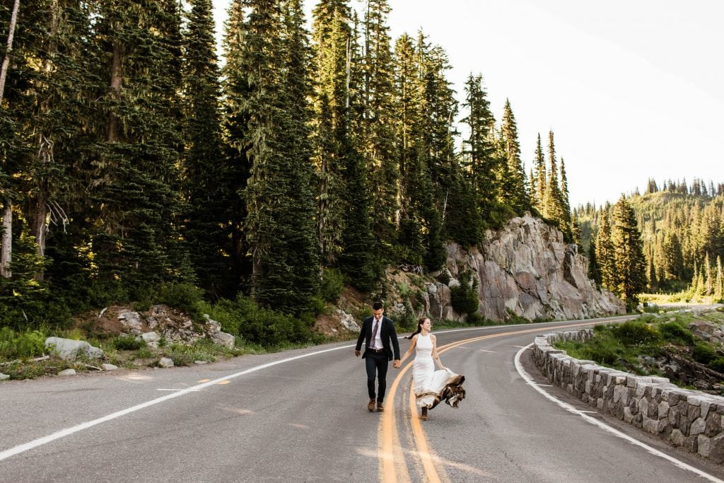 photo of couple running through the mountains of Washington during their elopement