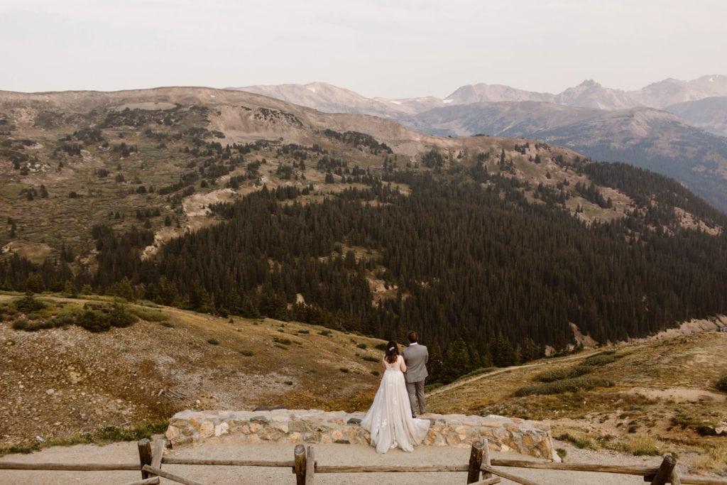 couple eloping at a high alpine overlook | elopement planning checklist