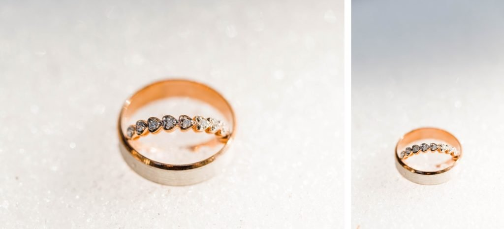 wedding rings in the snow during a Sapphire Point Overlook wedding