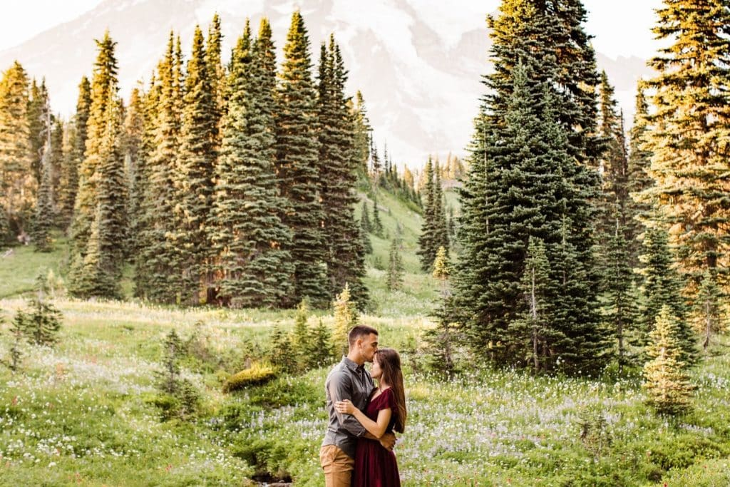 couple admiring the view in the mountains of WA during their Seattle engagement photos