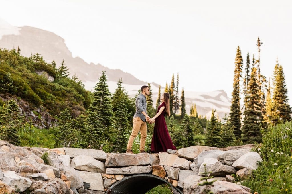 engaged couple kissing in the mountains during their engagement photos in Seattle WA