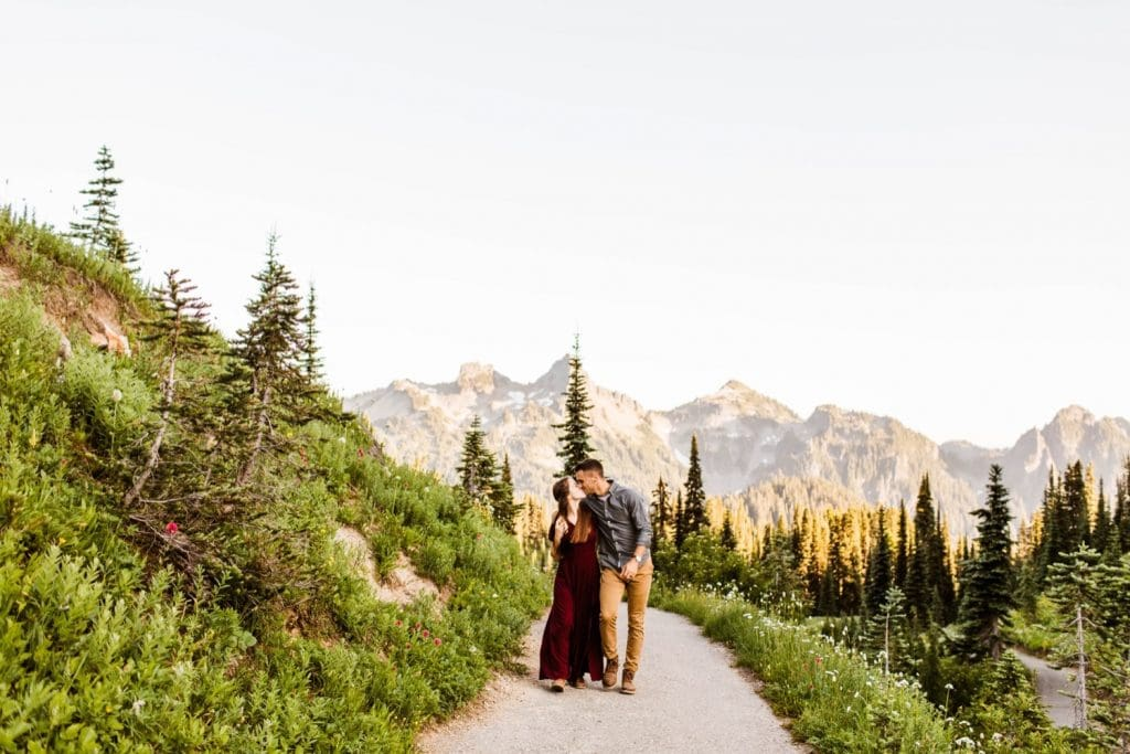 engaged couple walking down a hiking trail in a national park during their engagement photos in Seattle WA
