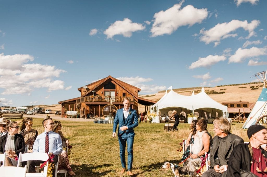groom walking down the aisle during his small wedding in Telluride on a horse ranch on Wilson Mesa