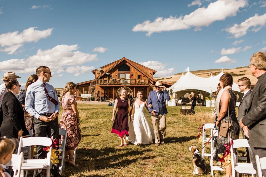 bride walking down the aisle during her small wedding in Telluride on a horse ranch on Wilson Mesa