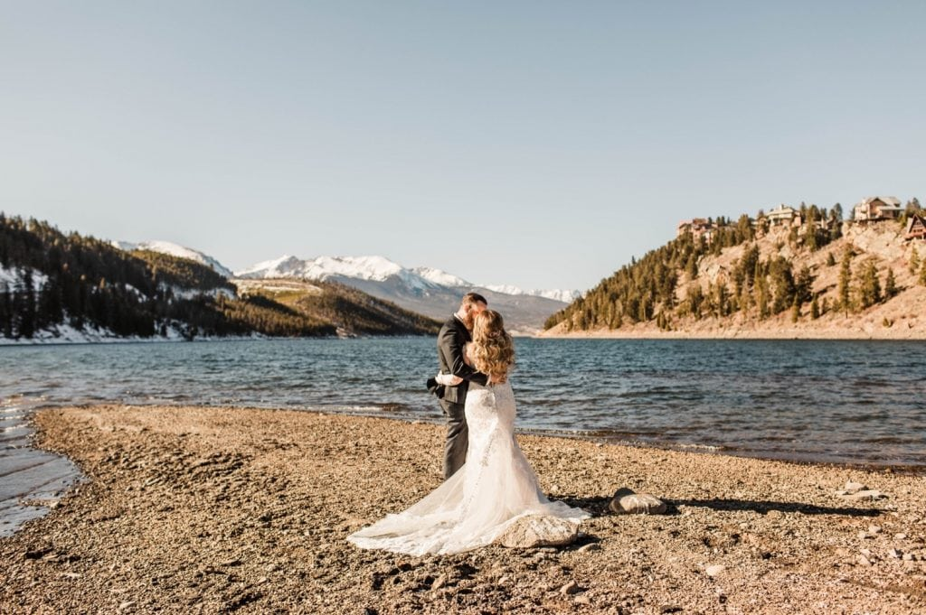 couple admiring the view of Lake Dillon before they getting married at Sapphire Point Overlook
