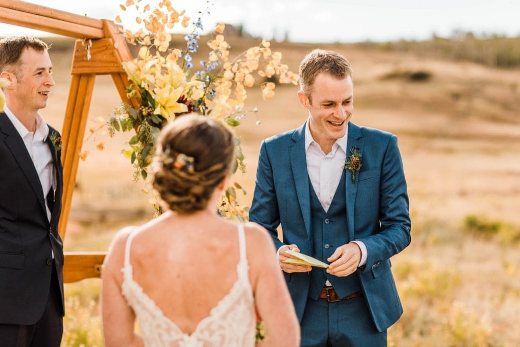 vow reading during a mountainous Telluride wedding ceremony at a horse ranch on Wilson Mesa