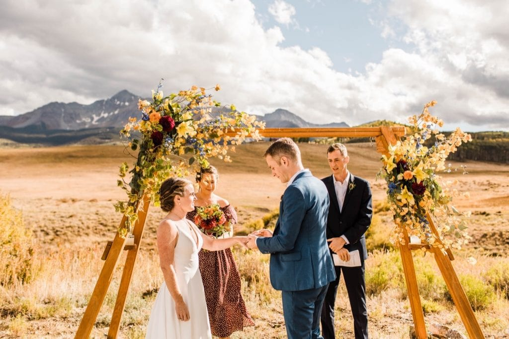 ring exchange during a mountainous Telluride wedding ceremony at a horse ranch on Wilson Mesa