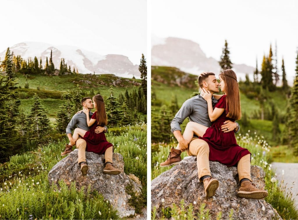 couple kissing on a rock in the middle of a wildflower field during their engagement photos in Seattle