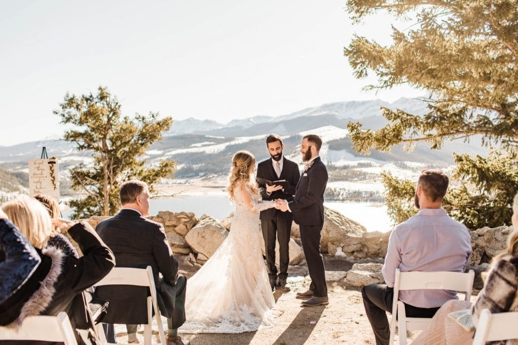 couple standing together and holding hands during their Sapphire Point Overlook wedding ceremony
