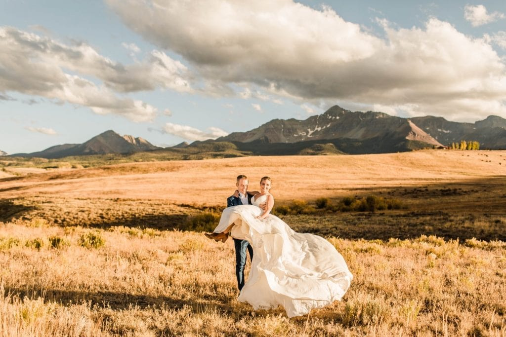 adventurous couples photos taken at sunset during a small Telluride wedding at a ranch on Wilson Mesa | photographed by Telluride Colorado wedding photographers